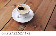 Купить «sugar falling into cup of coffee on wooden table», видеоролик № 22527172, снято 2 апреля 2016 г. (c) Syda Productions / Фотобанк Лори