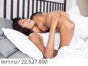 Купить «Young couple lying on bed and cuddling each other», фото № 22527800, снято 15 декабря 2015 г. (c) Wavebreak Media / Фотобанк Лори