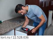 Купить «Man using cordless hand drill», фото № 22528036, снято 10 декабря 2015 г. (c) Wavebreak Media / Фотобанк Лори