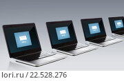 Купить «laptop computers with email message icon on screen», фото № 22528276, снято 14 ноября 2013 г. (c) Syda Productions / Фотобанк Лори