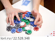 Купить «hands with casino chips making bet or taking win», фото № 22528348, снято 22 марта 2014 г. (c) Syda Productions / Фотобанк Лори