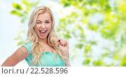 Купить «smiling young woman holding her strand of hair», фото № 22528596, снято 13 февраля 2016 г. (c) Syda Productions / Фотобанк Лори