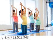 Купить «happy pregnant women exercising on mats in gym», фото № 22528948, снято 5 марта 2016 г. (c) Syda Productions / Фотобанк Лори