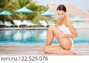 Купить «beautiful young woman over beach swimming pool», фото № 22529076, снято 25 июля 2013 г. (c) Syda Productions / Фотобанк Лори