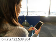 Купить «Woman use of mobile phone in departure hall in airport», фото № 22538804, снято 20 октября 2018 г. (c) PantherMedia / Фотобанк Лори