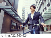 Купить «Successful businessman riding bicycle», фото № 22540624, снято 21 марта 2015 г. (c) Sergey Nivens / Фотобанк Лори