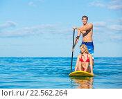 Купить «Couple Stand Up Paddle Surfing In Hawaii, Beautiful Tropical Ocean, Active Beach Lifestyle», фото № 22562264, снято 19 ноября 2018 г. (c) easy Fotostock / Фотобанк Лори