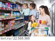 Купить «customers with children selecting sweet dairy products in hypermarket», фото № 22569360, снято 19 сентября 2018 г. (c) Яков Филимонов / Фотобанк Лори