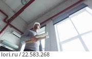Купить «architect or builder in helmet with blueprint», видеоролик № 22583268, снято 31 января 2016 г. (c) Syda Productions / Фотобанк Лори