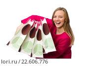 Купить «Shopper girl in pink dress holding plastic bags isolated on whit», фото № 22606776, снято 5 января 2015 г. (c) Elnur / Фотобанк Лори
