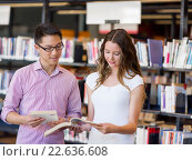 Two young students at the library, фото № 22636608, снято 25 ноября 2014 г. (c) Sergey Nivens / Фотобанк Лори