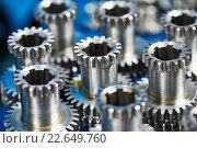 Купить «metal cog wheel gears», фото № 22649760, снято 18 мая 2015 г. (c) Дмитрий Калиновский / Фотобанк Лори