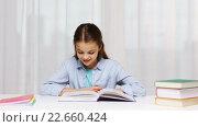 Купить «happy school girl reading book or textbook at home», видеоролик № 22660424, снято 12 декабря 2015 г. (c) Syda Productions / Фотобанк Лори