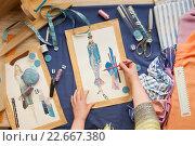 Купить «Table of skilled tailors working», фото № 22667380, снято 24 марта 2016 г. (c) Владимир Мельников / Фотобанк Лори