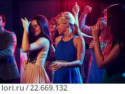Купить «group of happy friends dancing in night club», фото № 22669132, снято 20 октября 2014 г. (c) Syda Productions / Фотобанк Лори