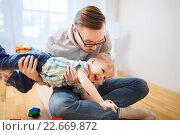 Купить «father with son playing and having fun at home», фото № 22669872, снято 19 марта 2016 г. (c) Syda Productions / Фотобанк Лори