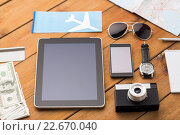 Купить «close up of smartphone and travel stuff», фото № 22670040, снято 8 февраля 2016 г. (c) Syda Productions / Фотобанк Лори