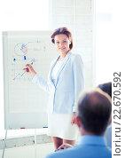Купить «businesswoman working with flip board in office», фото № 22670592, снято 9 июня 2013 г. (c) Syda Productions / Фотобанк Лори