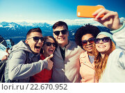 Купить «smiling friends taking selfie with smartphone», фото № 22670952, снято 19 марта 2015 г. (c) Syda Productions / Фотобанк Лори