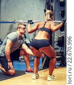 Купить «man and woman with barbell flexing muscles in gym», фото № 22670996, снято 19 апреля 2015 г. (c) Syda Productions / Фотобанк Лори