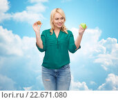 Купить «smiling woman choosing between apple and cookie», фото № 22671080, снято 7 февраля 2016 г. (c) Syda Productions / Фотобанк Лори