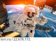 Купить «International Space Station and astronaut.», фото № 22678172, снято 3 апреля 2016 г. (c) Андрей Армягов / Фотобанк Лори