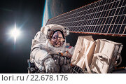 Купить «International Space Station and astronaut.», фото № 22678176, снято 22 сентября 2018 г. (c) Андрей Армягов / Фотобанк Лори