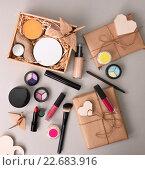 Купить «Свертки с разнообразной косметикой и средствами ухода за кожей», фото № 22683916, снято 1 февраля 2016 г. (c) Jan Jack Russo Media / Фотобанк Лори