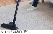 Купить «woman with vacuum cleaner cleaning carpet at home», видеоролик № 22689804, снято 17 апреля 2016 г. (c) Syda Productions / Фотобанк Лори