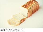 Купить «close up of white sliced toast bread on table», фото № 22698572, снято 22 мая 2015 г. (c) Syda Productions / Фотобанк Лори