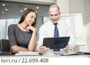 Купить «smiling businesspeople with tablet pc in office», фото № 22699408, снято 25 октября 2014 г. (c) Syda Productions / Фотобанк Лори