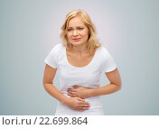 Купить «unhappy woman suffering from stomach ache», фото № 22699864, снято 27 ноября 2015 г. (c) Syda Productions / Фотобанк Лори