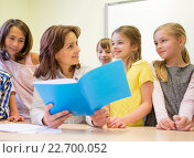 Купить «group of school kids with teacher in classroom», фото № 22700052, снято 15 ноября 2014 г. (c) Syda Productions / Фотобанк Лори