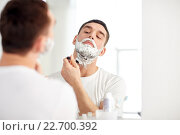 Купить «man shaving beard with razor blade at bathroom», фото № 22700392, снято 15 января 2016 г. (c) Syda Productions / Фотобанк Лори