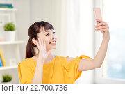 Купить «happy asian woman taking selfie with smartphone», фото № 22700736, снято 9 марта 2016 г. (c) Syda Productions / Фотобанк Лори