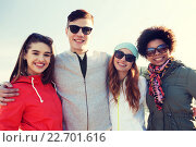 Купить «happy teenage friends in shades hugging outdoors», фото № 22701616, снято 19 марта 2015 г. (c) Syda Productions / Фотобанк Лори
