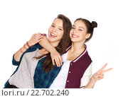 Купить «happy teenage girls hugging and showing peace sign», фото № 22702240, снято 19 декабря 2015 г. (c) Syda Productions / Фотобанк Лори