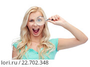 happy young woman with magnifying glass. Стоковое фото, фотограф Syda Productions / Фотобанк Лори