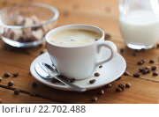 Купить «close up coffee cup and grains on wooden table», фото № 22702488, снято 7 апреля 2016 г. (c) Syda Productions / Фотобанк Лори