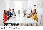 Купить «creative team with computers, blueprint at office», фото № 22703676, снято 27 февраля 2016 г. (c) Syda Productions / Фотобанк Лори