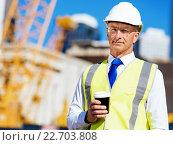 Купить «Engineer builder at construction site», фото № 22703808, снято 5 апреля 2015 г. (c) Sergey Nivens / Фотобанк Лори
