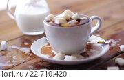 Купить «coffee cup full of lump sugar on wooden table», видеоролик № 22710420, снято 15 апреля 2016 г. (c) Syda Productions / Фотобанк Лори