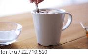 Купить «hand adding sugar to cup of tea or coffee», видеоролик № 22710520, снято 15 апреля 2016 г. (c) Syda Productions / Фотобанк Лори