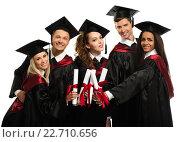 Купить «Multi ethnic group of graduated young students isolated on white», фото № 22710656, снято 24 апреля 2014 г. (c) Andrejs Pidjass / Фотобанк Лори