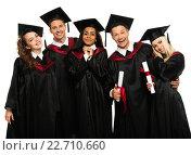 Купить «Multi ethnic group of graduated young students isolated on white», фото № 22710660, снято 24 апреля 2014 г. (c) Andrejs Pidjass / Фотобанк Лори
