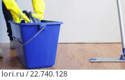 Купить «woman washing and squeezing rag in bucket at home», видеоролик № 22740128, снято 17 апреля 2016 г. (c) Syda Productions / Фотобанк Лори