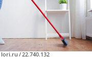 Купить «woman with broom cleaning floor at home», видеоролик № 22740132, снято 17 апреля 2016 г. (c) Syda Productions / Фотобанк Лори