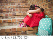 Купить «Sad schoolgirl with head into her legs», фото № 22753124, снято 5 марта 2016 г. (c) Wavebreak Media / Фотобанк Лори