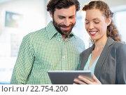 Купить «Businessman and businesswoman discuss using digital tablet», фото № 22754200, снято 13 марта 2016 г. (c) Wavebreak Media / Фотобанк Лори