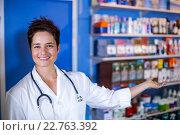 Купить «Smiling woman vet showing the medicine chest», фото № 22763392, снято 17 января 2016 г. (c) Wavebreak Media / Фотобанк Лори